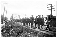 World War I soldiers crossing the bridge